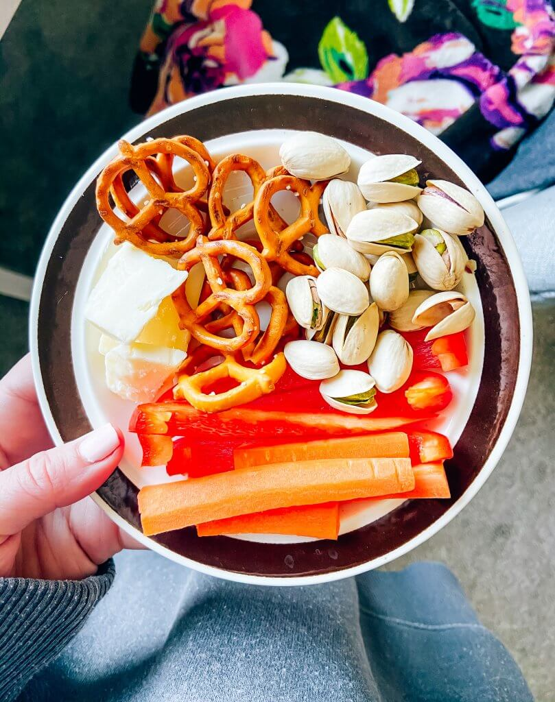 dietitian approved healthy snacks; snack plate with pretzels, cheese, pistachios and carrots