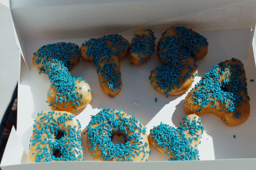 "popular boy names 2020; box of donuts ""it's a boy"""
