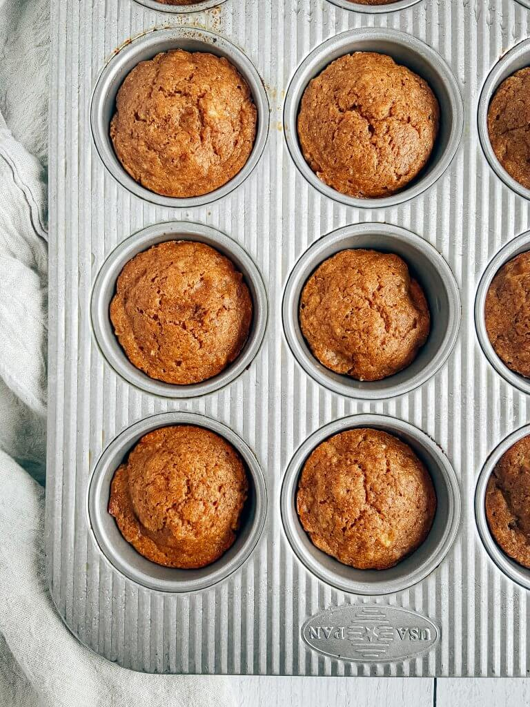 healthy gingerbread muffins in muffin pan