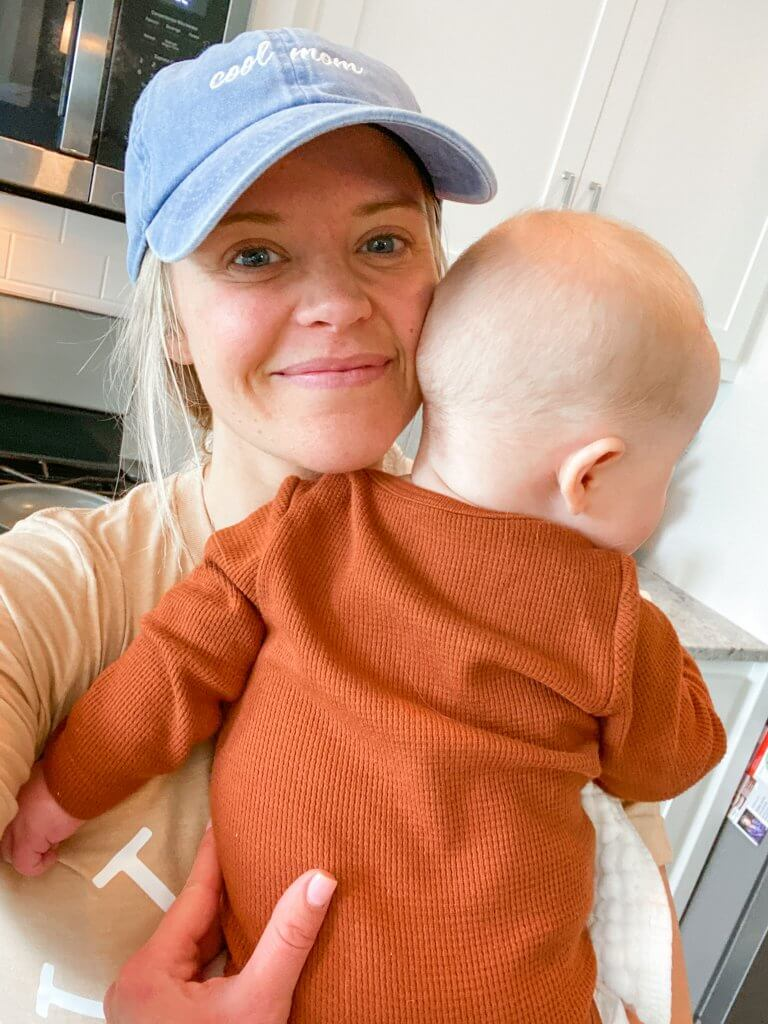 best podcasts for moms; picture of mom holding baby